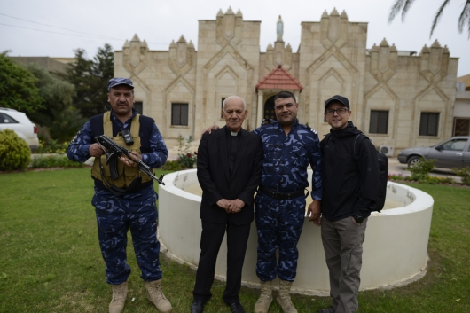 Muslim Guards protecting a Christian Church. I love it.